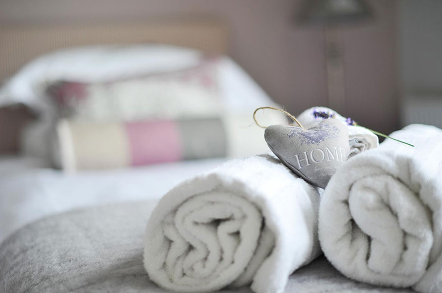 Rolled up towels with home heart and lavender